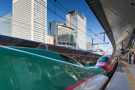 TOKYO, JAPAN - October 26 : A Shinkansen train pulls into Tokyo Station on October 26, 2015 in Tokyo, Japan.