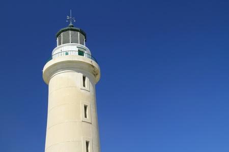Lighthouse under bright blue sky