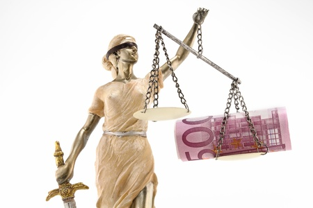 Justice  greek themis,latin justitia  blindfolded with scales, sword and money on one scale  Corruption and bribing concept photo