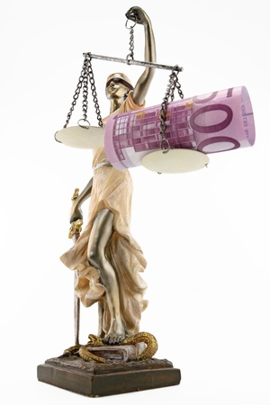 unethical: Justice  greek themis,latin justitia  blindfolded with scales, sword and money on one scale  Corruption and bribing concept Stock Photo