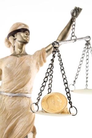 pound coin: Justice  greek themis,latin justitia  blindfolded with scales, sword and money on one scale  Corruption and bribing concept Stock Photo