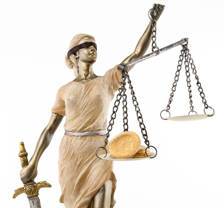 trial: Justice  greek themis,latin justitia  blindfolded with scales, sword and money on one scale  Corruption and bribing concept Stock Photo