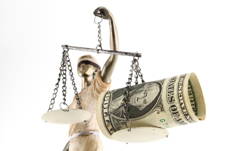 human settlement: Justice  greek themis,latin justitia  blindfolded with scales, sword and money on one scale  Corruption and bribing concept Stock Photo