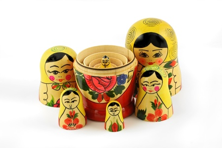 Russian nesting dolls ( babushkas or matryoshkas ) isolated on white background Standard-Bild