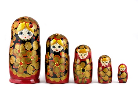 Russian nesting dolls ( babushkas or matryoshkas ) isolated on white background photo
