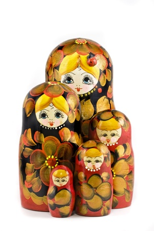 nesting: Russian nesting dolls ( babushkas or matryoshkas ) isolated on white background Stock Photo