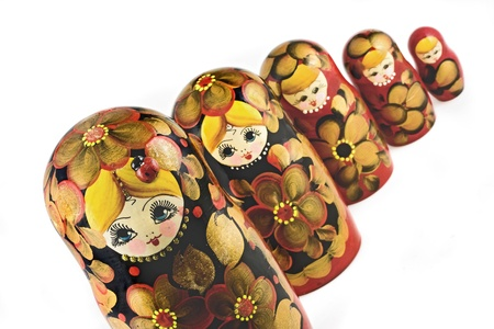 Russian nesting dolls ( babushkas or matryoshkas ) isolated on white background Stock Photo - 12584298