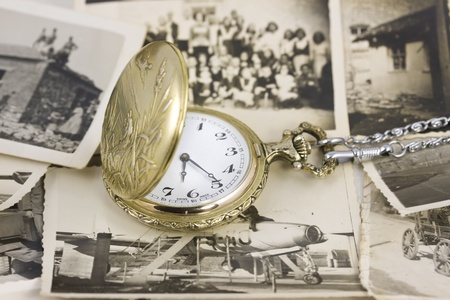 vintage pocket watch with photo background photo