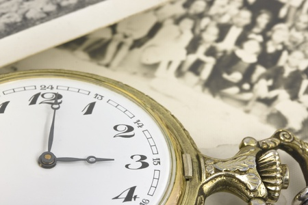 vintage pocket watch with b&w photo background