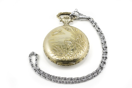 winder: vintage pocket watch isolated on white