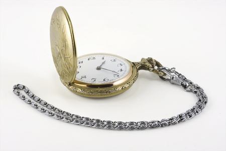 vintage pocket watch isolated on white photo