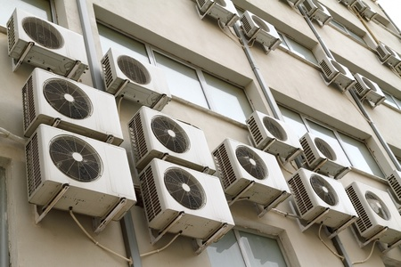 global cooling: Air conditioning units on exterior of public building  Energy consumption and global warming concept