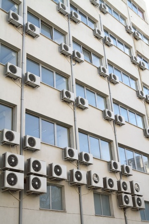 Air conditioning units on exterior of public building  Energy consumption and global warming concept