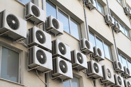 refrigerant: Air conditioning units on exterior of public building  Energy consumption and global warming concept