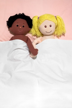 rags: Interracial couple concept , with handmade rag dolls Stock Photo