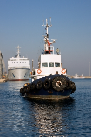 tug boat: Tugboat returning to base, after towing a cruise ship