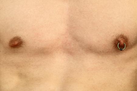 nipple piercing: Nipple piercing Stock Photo