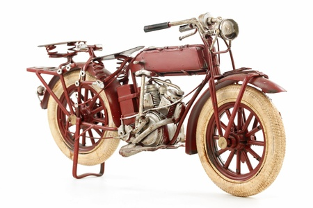 Handmade tin 1930 s vintage motorcycle model, isolated Stock Photo