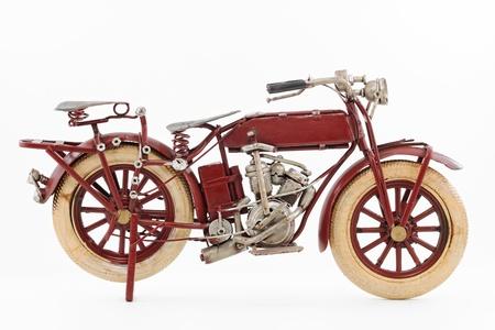 Handmade tin 1930 s vintage motorcycle model, isolated Stok Fotoğraf