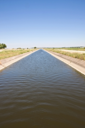Irrigation channel in the Greek countryside  Stock Photo
