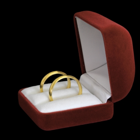 A pair of wedding rings on black background Stock Photo