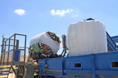 Garbage packing machine in landfill