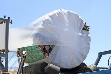 waste disposal: Garbage packing machine in landfill