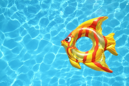 Fish shaped lifebuoy on swimming pool photo