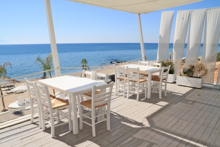 Typical greek tavern - cafe on balcony, by the mediterranean sea photo