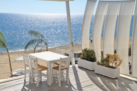 balcony view: Typical greek tavern - cafe on balcony, by the mediterranean sea Stock Photo