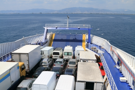 ferry boat loaded with cars and trucks Stock Photo