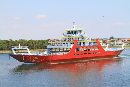 ferries: ferry boat leaving the port Stock Photo