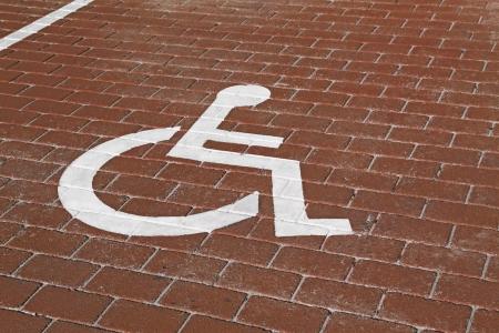 Handicapped sign in parking lot Standard-Bild