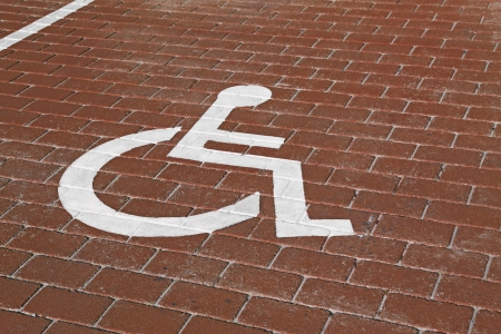 reserved seat: Handicapped sign in parking lot Stock Photo