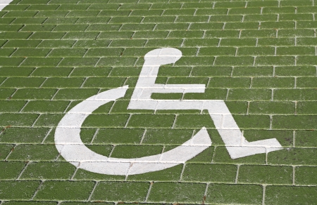 disabled parking sign: Handicapped sign in parking lot Stock Photo