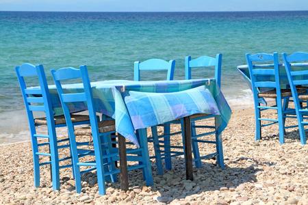 Typical greek tavern - cafe , by the aegean sea Stok Fotoğraf