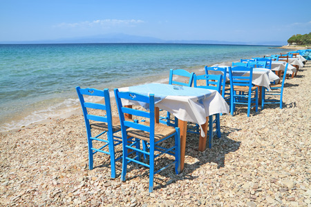 aegean sea: Typical greek tavern - cafe , by the aegean sea Stock Photo