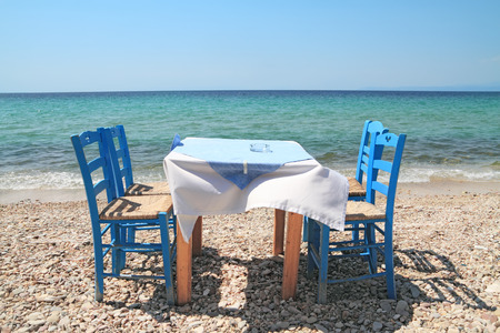 Typical greek tavern - cafe , by the aegean sea Stock Photo