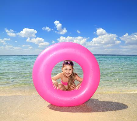 Happy girl with lifebuoy enjoying water Stok Fotoğraf