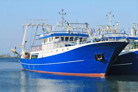 fishing ship: Modern steel fishing ships docked in port