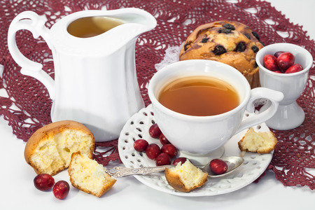 tea, muffins and fresh cranberries for breakfast photo