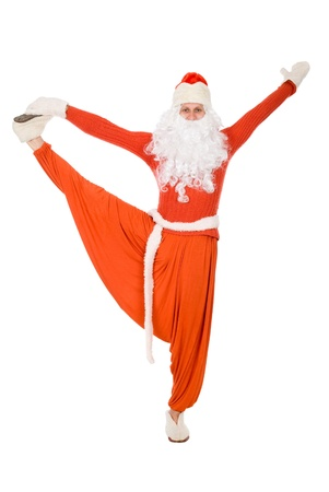 santa claus is making yoga isolated over white background