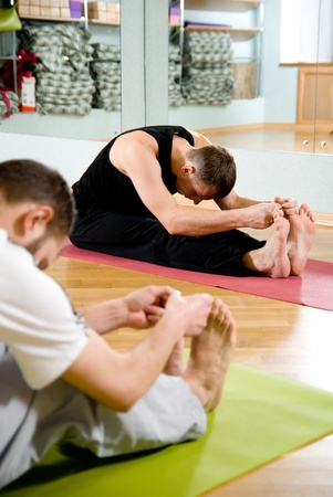 The trainer on yoga on training Stock Photo