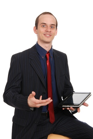enterprising: The young enterprising man with the laptop isolated on a white