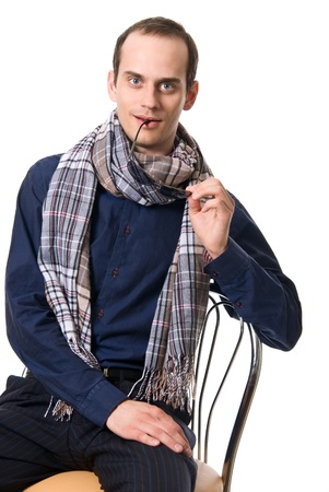 Portrait of the successful young guy with a scarf and glasses isolated on white background photo