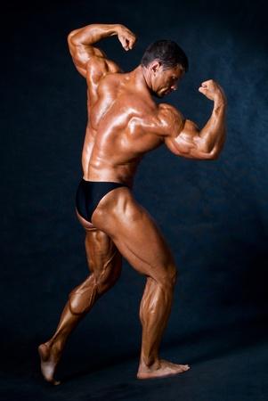 muscled: Muscled male model posing in studio