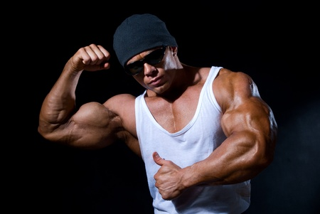 Handsome muscular man on a black background Stock Photo - 11783392