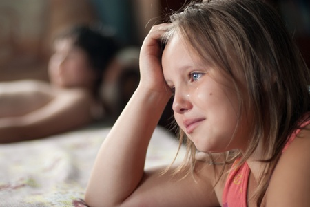 The girl watches film and cries Stock Photo