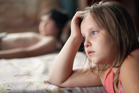The girl watches film and cries Stock Photo - 12064578