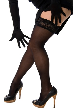 Sexy legs in black stockings and shoes in studio isolated on white background Stock Photo - 12061695